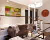Facing Sofas, Gas Fireplace, Taupe Marble Fireplace, Cable Stair Railing, Black Doors