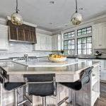 Custom Wood Work, Quartz Backsplash and island, Heathered Absolute Black Granite Perimeter Countertop, Hickory Perimeter Island Countertop, Sunpan Barstools, Black Painted Mullions, Riverside, Greenwich