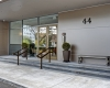 Brass Doors, Clean Store Front, Condo Entrance, Glass Entrance, Bluestone Steps, Champagne Metal Cladding, Sunpan Cement Bench