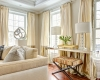 beige sofa, silk drapes, striped bench, trim on drapes, two color drapes, color-block drapes, two fabric sofa pedestal, stainless sculpture,