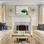 Carrara Fireplace surround, beige sofas, facing sofas, two coffee tables, symmetry, asymmetry, silk drapes