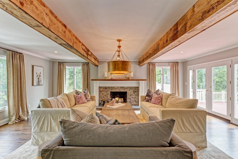 Eco-friendly sustainable reclaimed wood design, copper pendants, copper lighting, stone fireplace surround, black walnut mantel